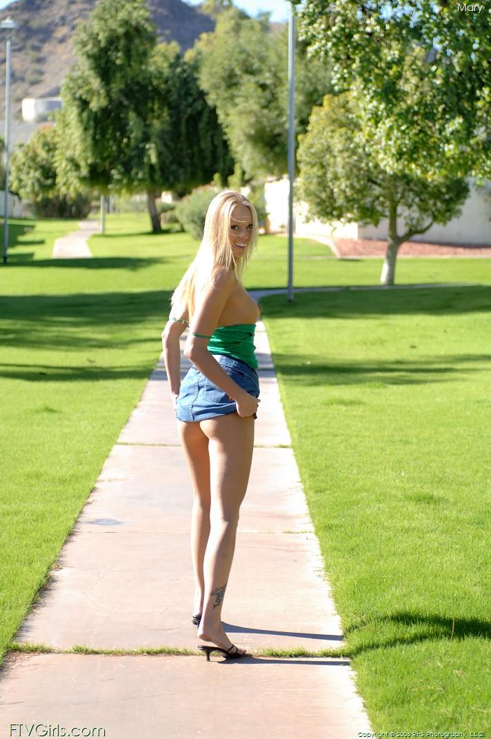 Hot blonde in a public park getting naked - 14