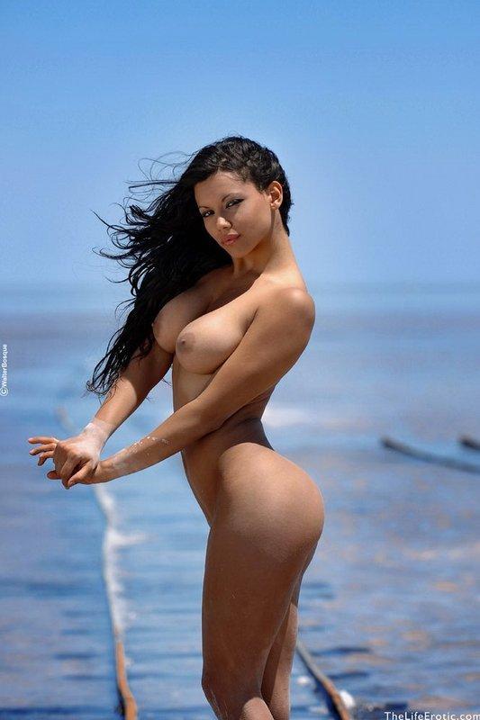Gorgeous brunette on the beach - 5
