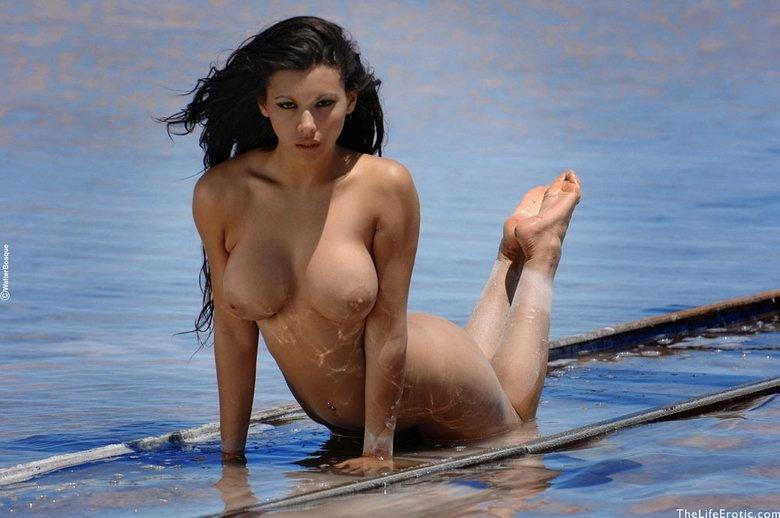 Gorgeous brunette on the beach - 8