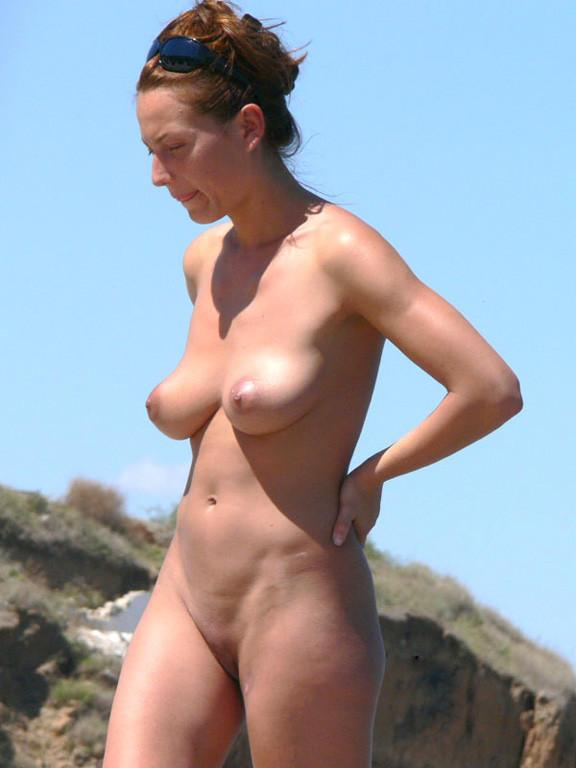 Pretty nudists on the beach - 12