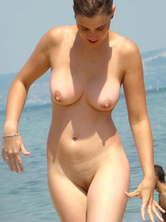 Pretty nudists on the beach - 21