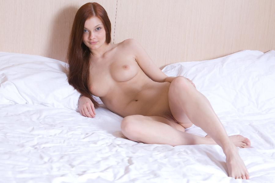 Cute red head Indiana on a bed - 15