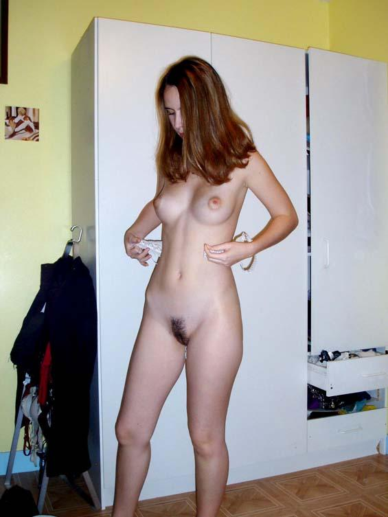 Pretty brunette nude at home  - 2