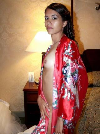 Marvelous brunette in hotel room