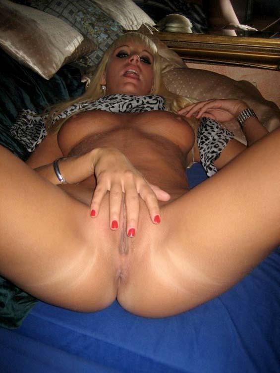 Gorgeous blonde spreads her legs - 5