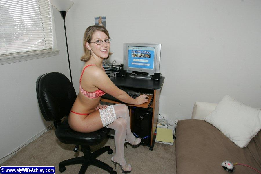 Ashley getting sexy in her office - 1
