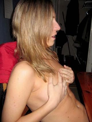 Playful blonde nude at home