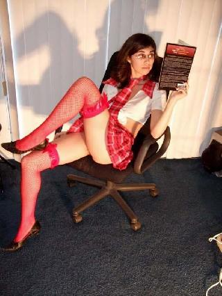 Sexy brunette dressed as schoolgirl