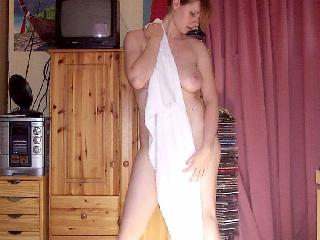 Busty girl gets naked at home