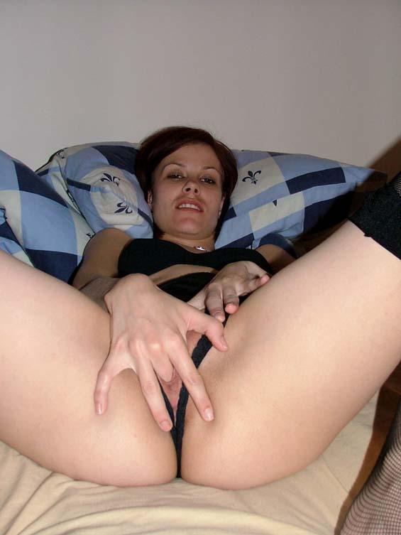 Skinny brunette spreads her legs - 5