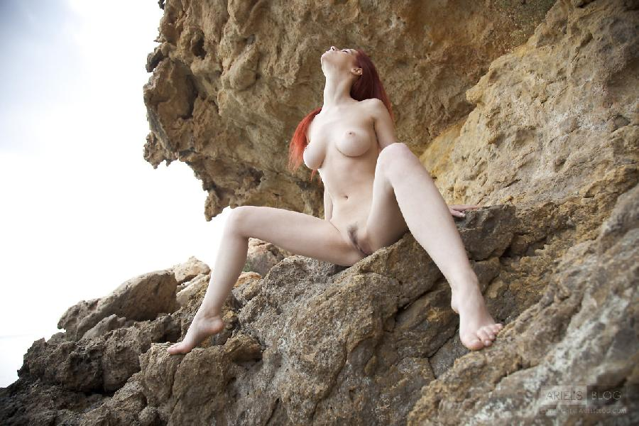 Great red head Ariel on the rock - 14