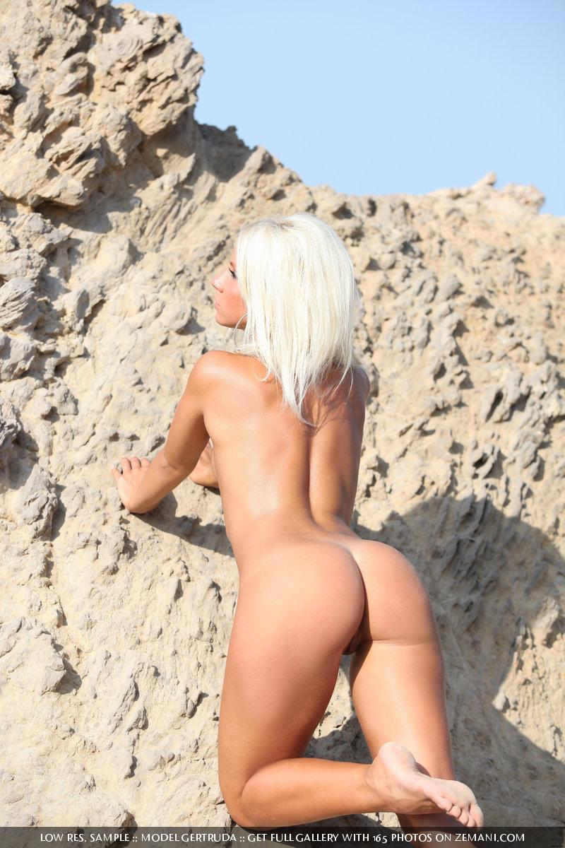 Depraved blonde in a tight-fitting mantle poses on a rock - Gertruda - 16