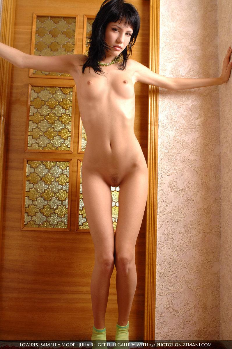Cute young brunette shows her perfect body in front of a door - Julia B - 10