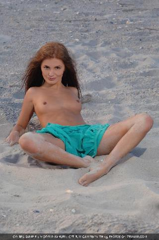Beautiful Emanuel takes off a blue dress on the beach and stays naked