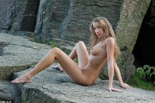 Cute chick posing on a rock - Irena