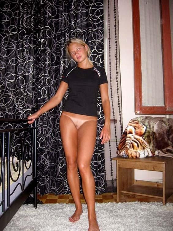 Young blonde shows her tan naked body - 3