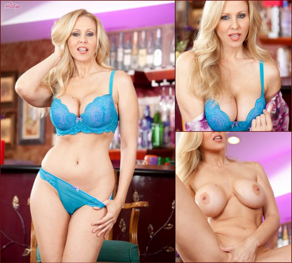 Busty babe shows shaved pussy in a bar - Julia Ann - 17