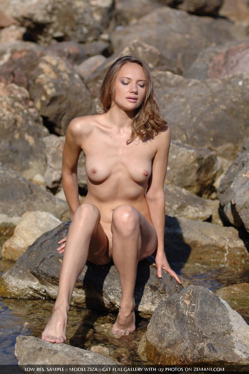 Pretty dark blonde takes her cloth off in the water and remains naked - Ziza - 1