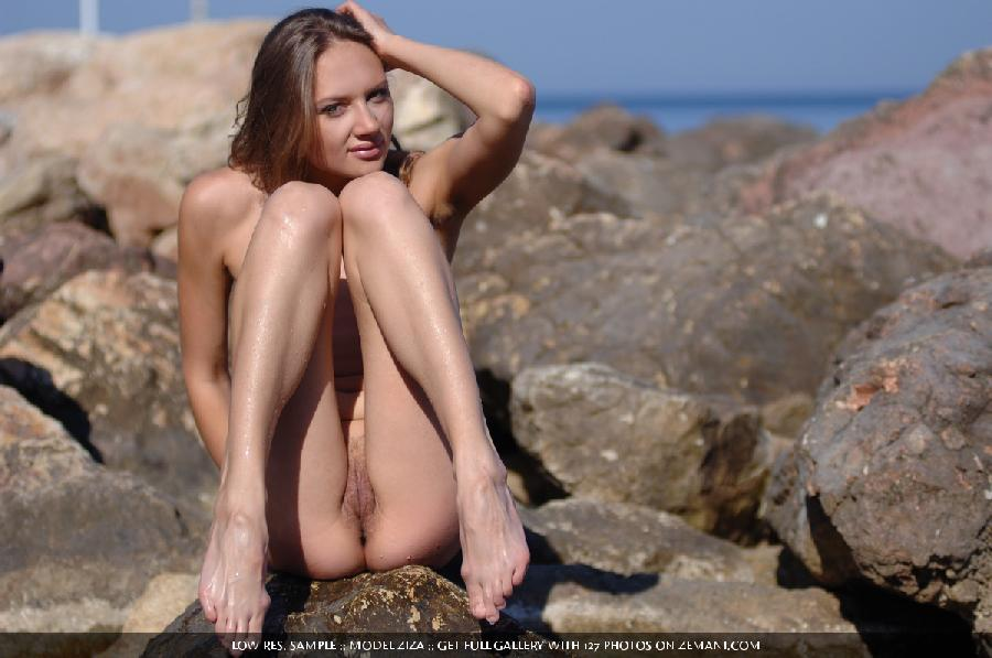 Pretty dark blonde takes her cloth off in the water and remains naked - Ziza - 2