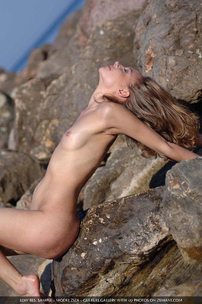 Pretty dark blonde takes her cloth off in the water and remains naked - Ziza - 4