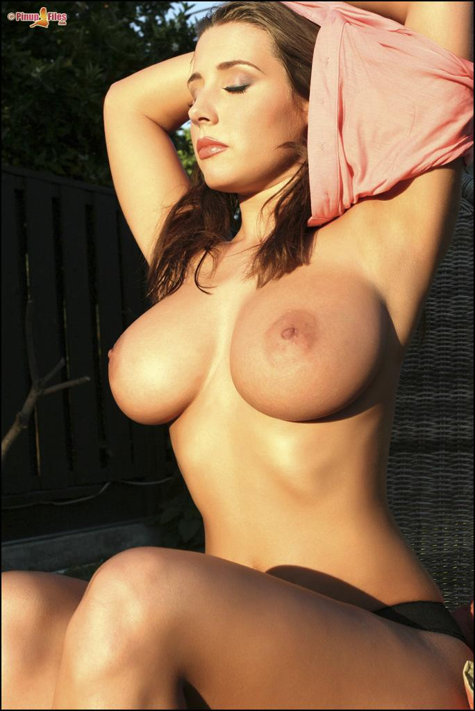Erica Campbell and her big tits get sun - 9