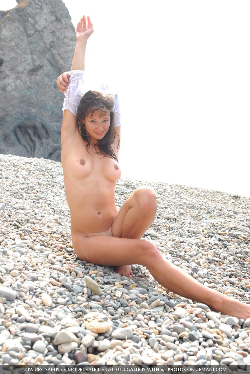 Beautiful busty girl poses nude on the pebble beach - Valeri - 10