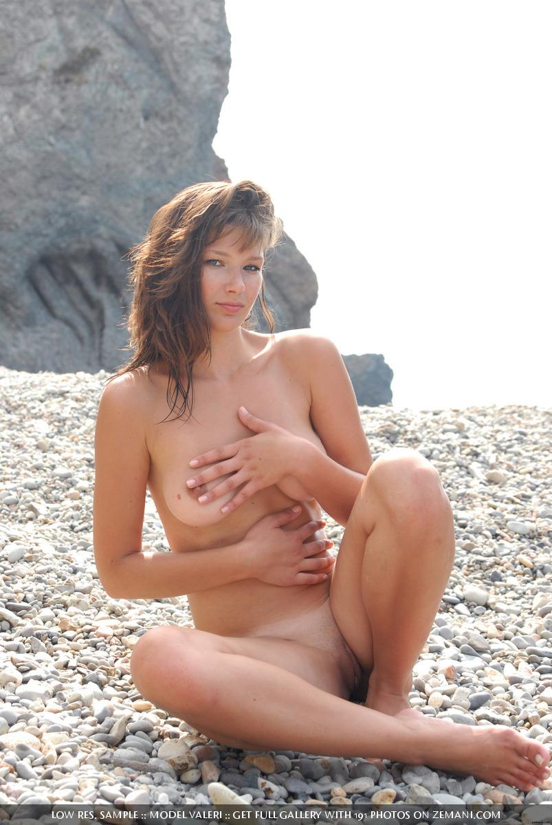 Beautiful busty girl poses nude on the pebble beach - Valeri - 11
