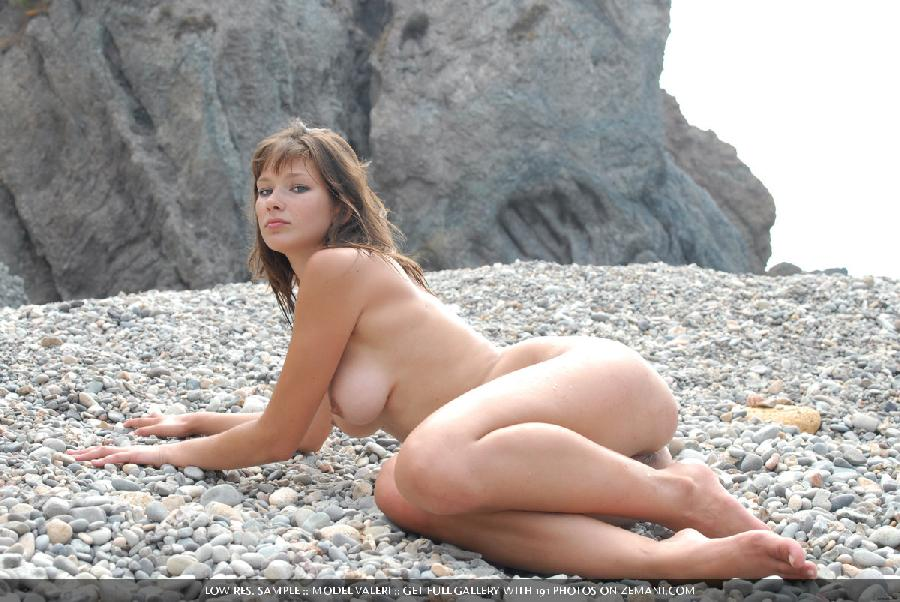 Beautiful busty girl poses nude on the pebble beach - Valeri - 13