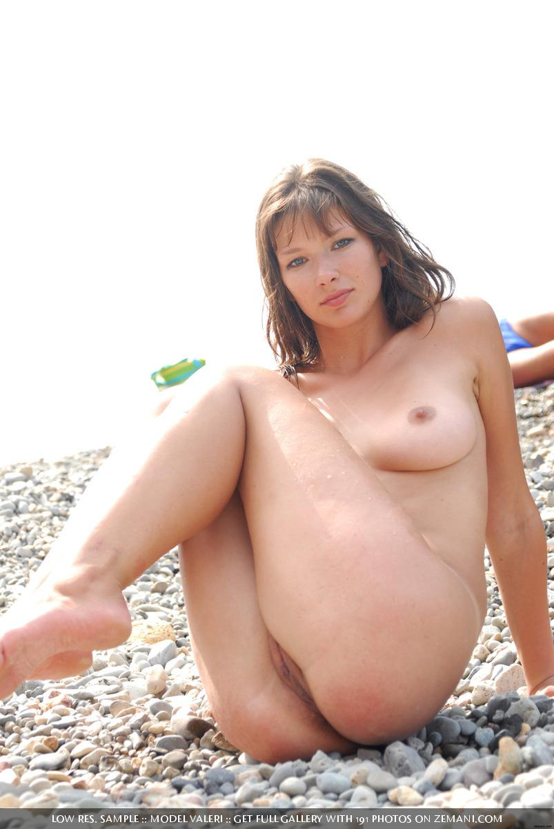 Beautiful busty girl poses nude on the pebble beach - Valeri - 14