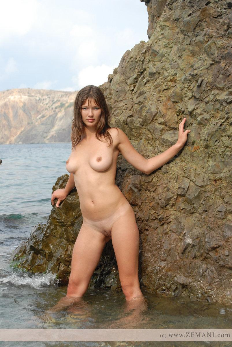 Beautiful busty girl poses nude on the pebble beach - Valeri - 16