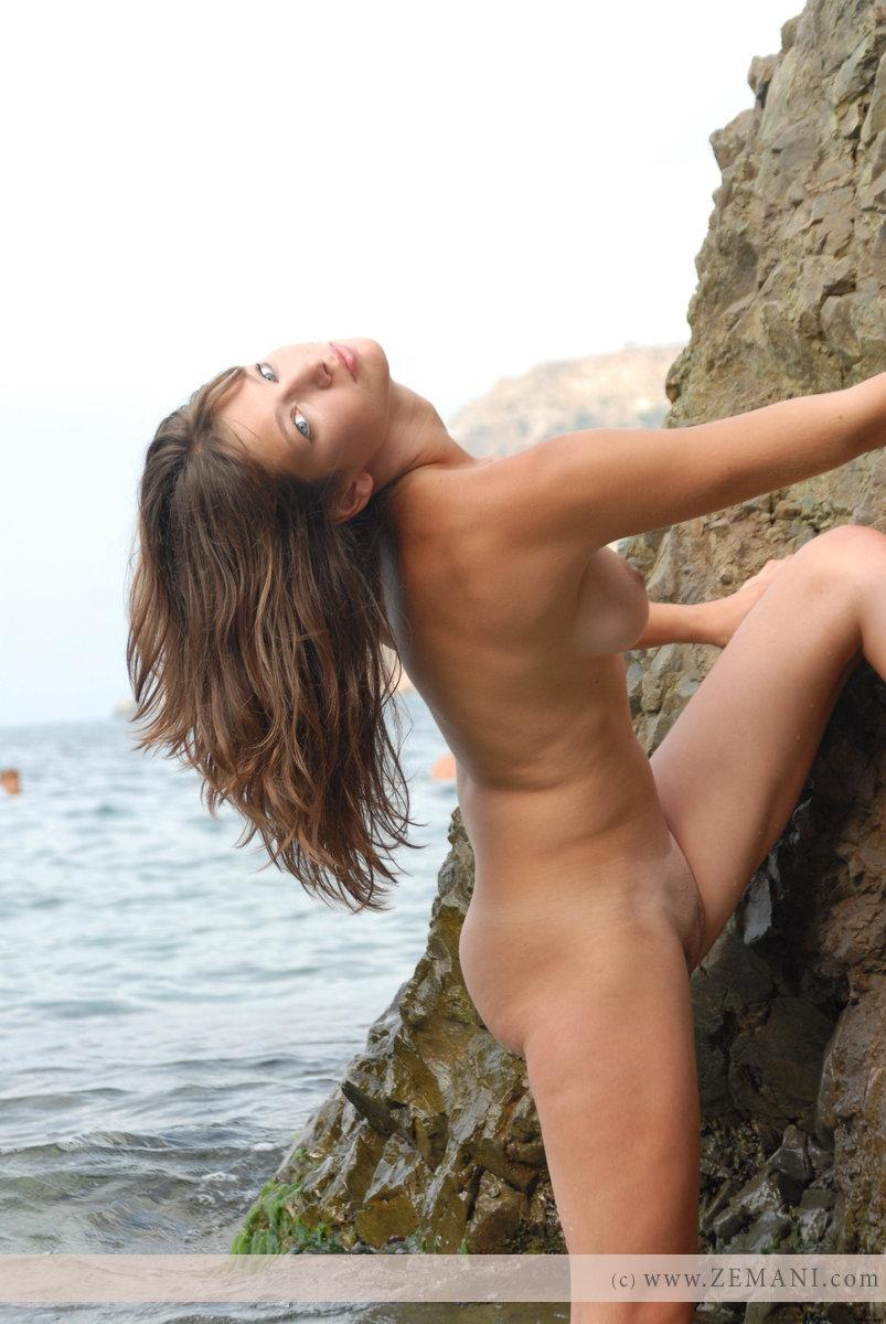 Beautiful busty girl poses nude on the pebble beach - Valeri - 17