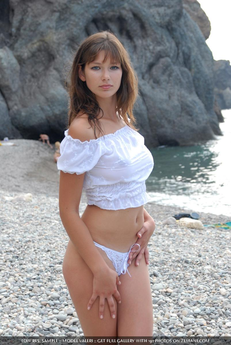 Beautiful busty girl poses nude on the pebble beach - Valeri - 2