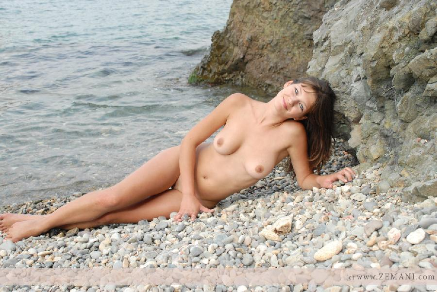 Beautiful busty girl poses nude on the pebble beach - Valeri - 24