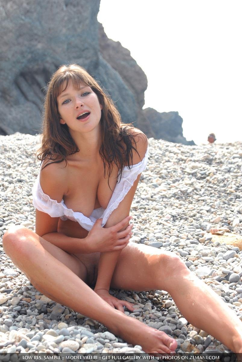 Beautiful busty girl poses nude on the pebble beach - Valeri - 6