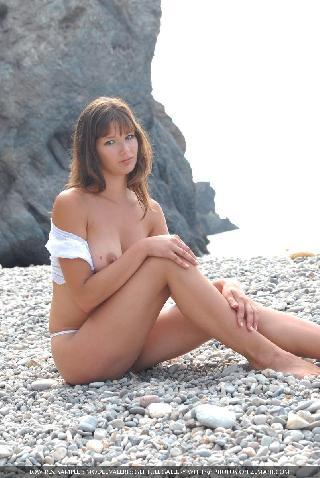Beautiful busty girl poses nude on the pebble beach - Valeri