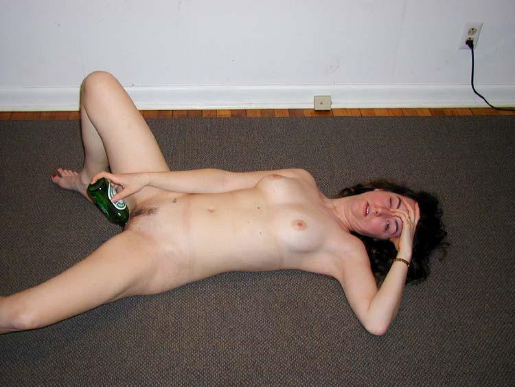hot drunk girl puts a bottle in naked pussy