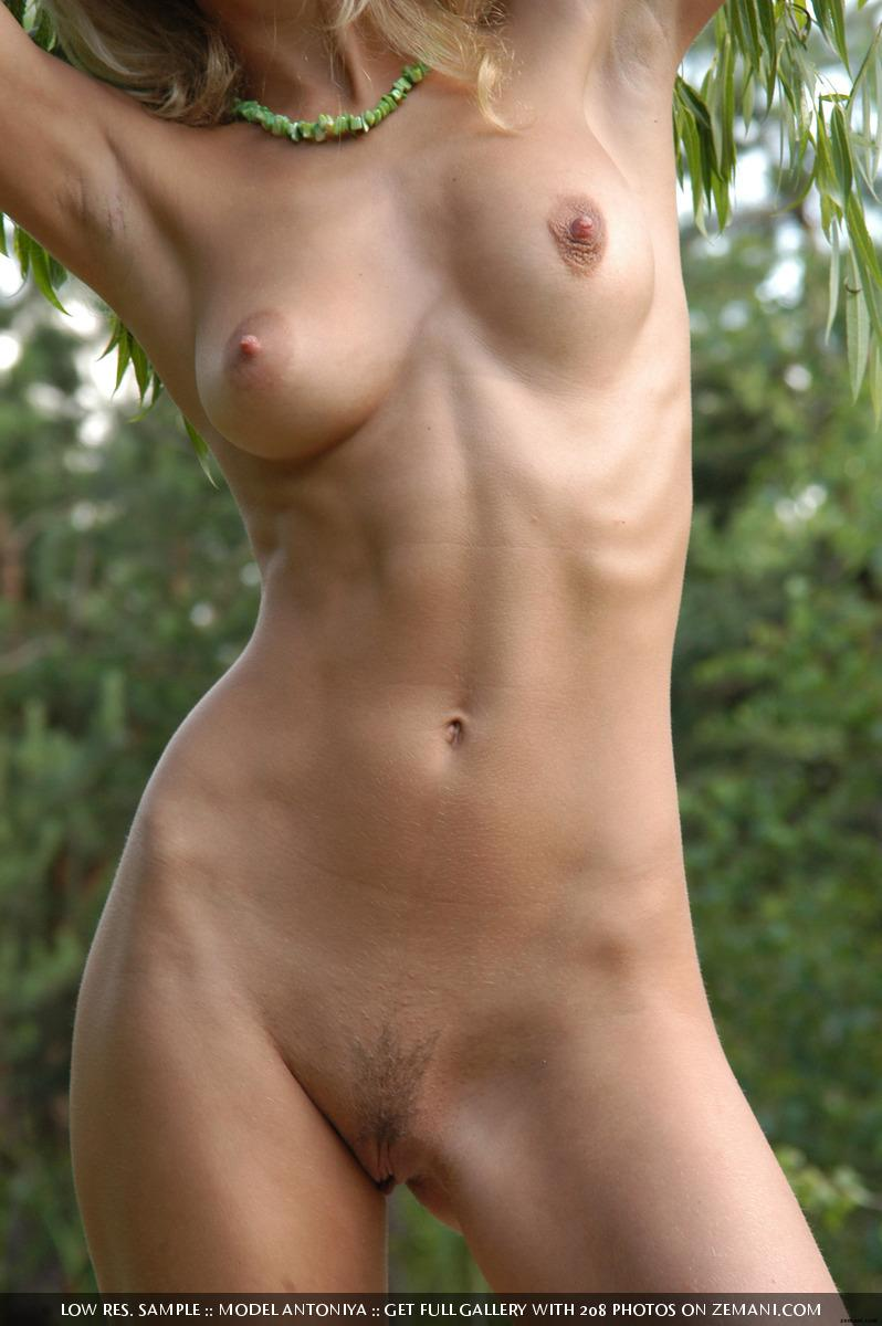 Hot and young blonde gets naked in the forest - Antoniya  - 11