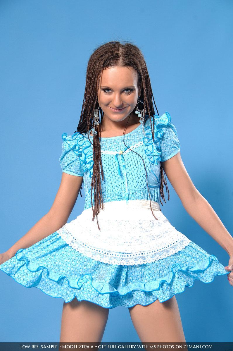 Playful young girl takes off her short blue dress - Zera A - 1