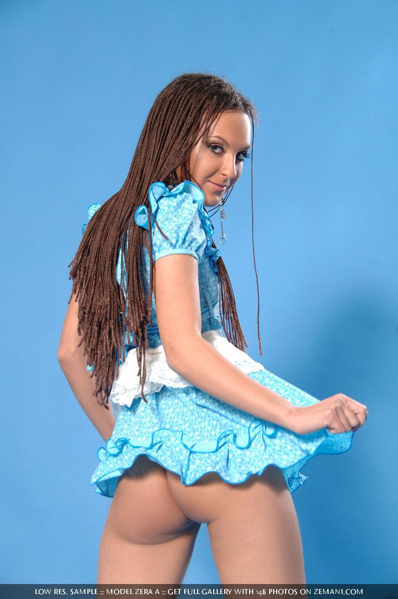 Playful young girl takes off her short blue dress - Zera A - 2