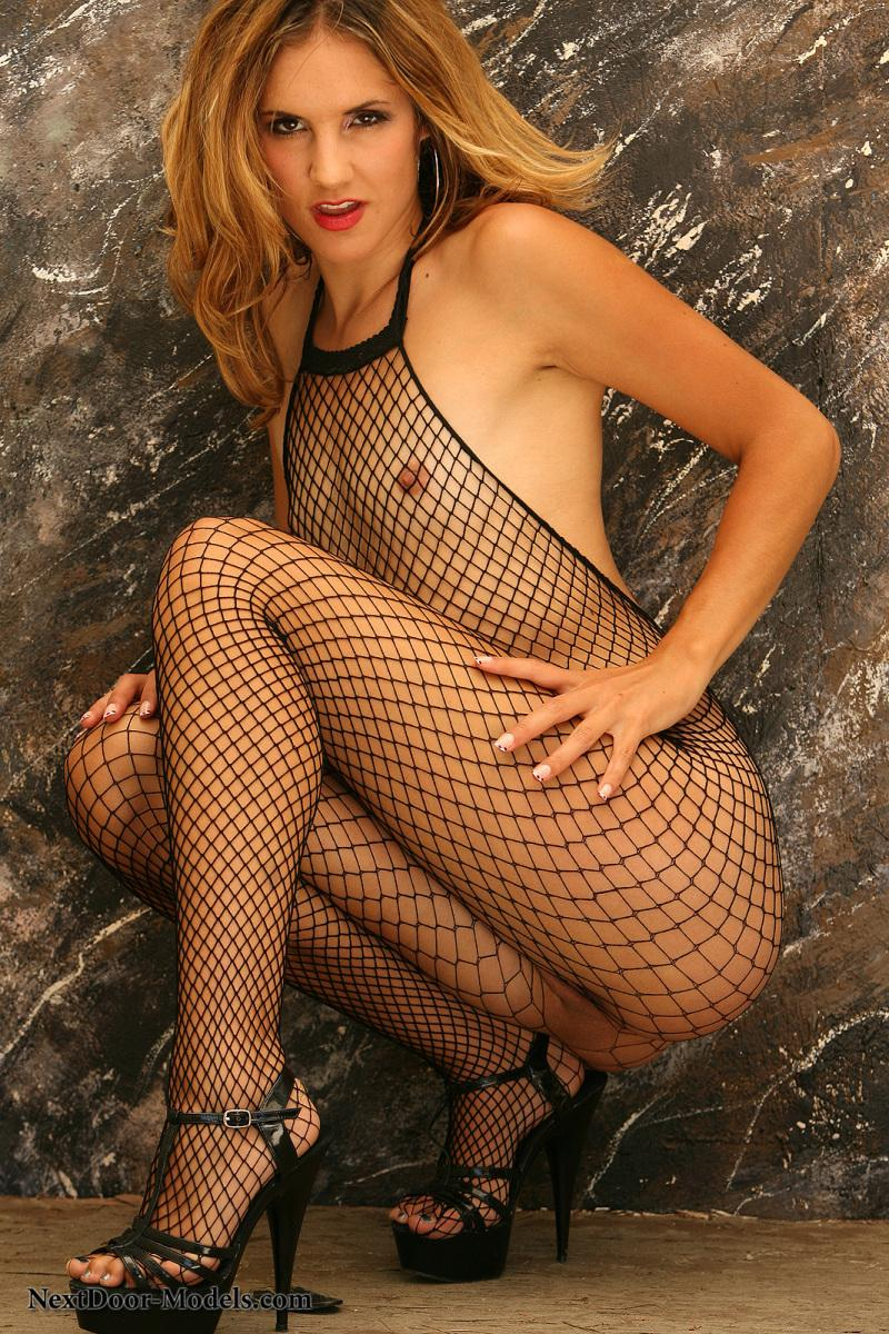 Fantasy Eva poses in black body stockings - 1
