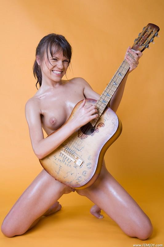 Amusing moment girl play guitar nude touching