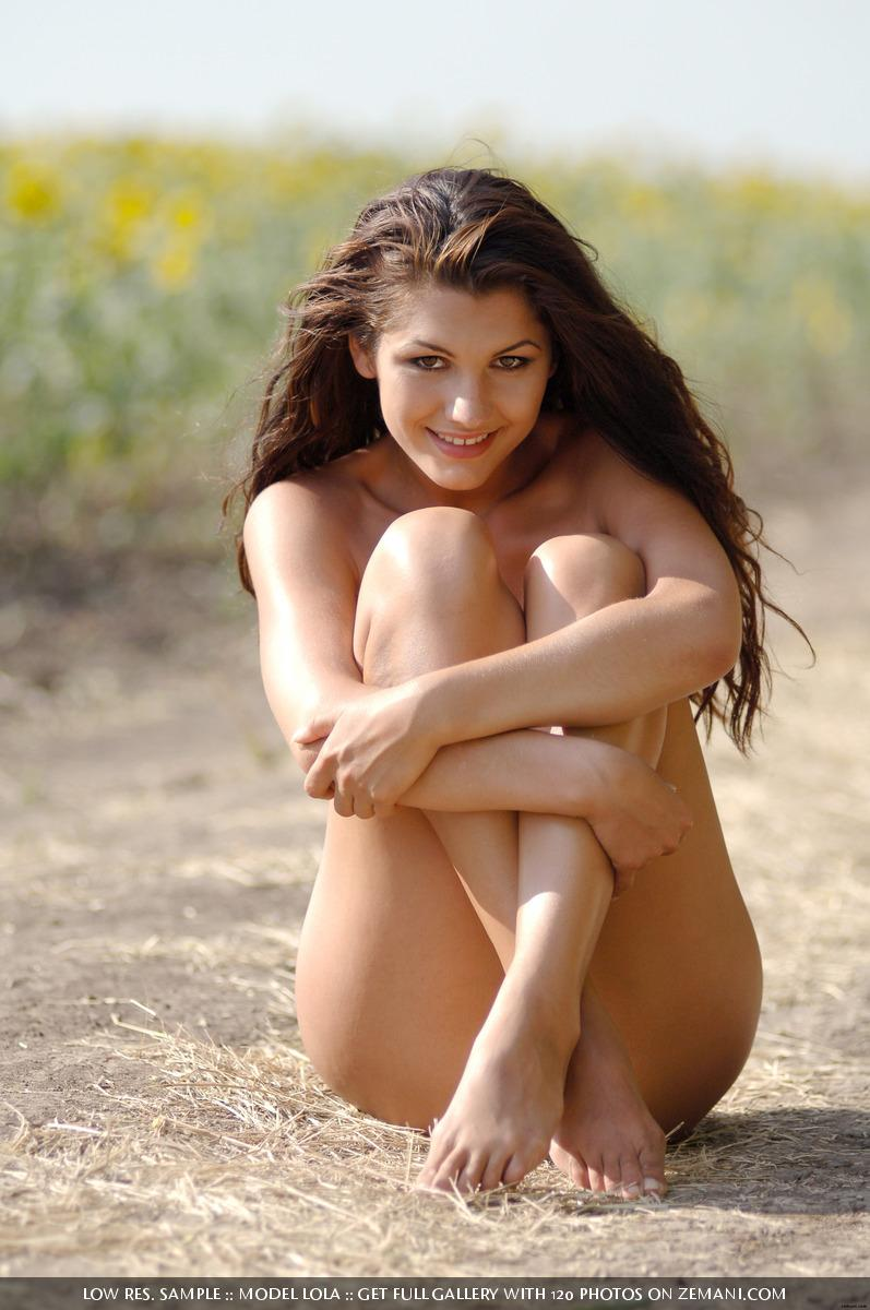 Naked brunette girl with nice figure in the sunflowers - Lola - 8