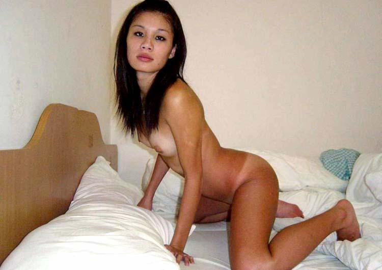 Asian girl is spreading her legs - 2