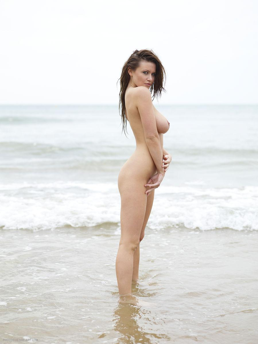 Marjana strips her pink bikini on the beach - 11