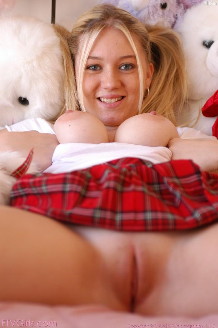 Dirty schoolgirl poses on a bed - Alison - 10