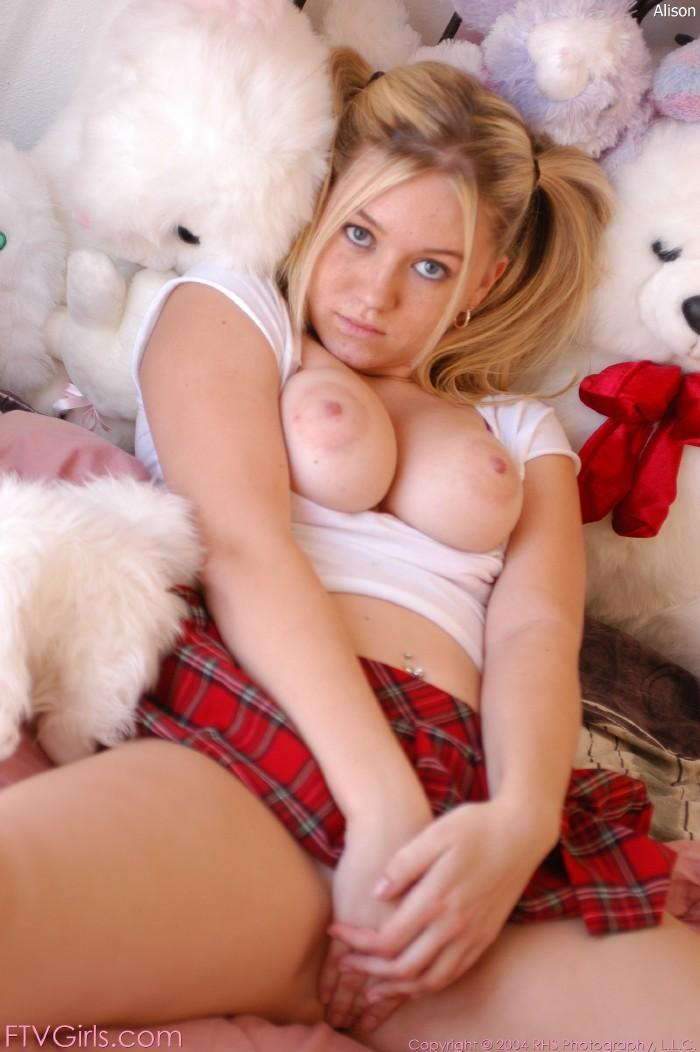 Dirty schoolgirl poses on a bed - Alison - 12