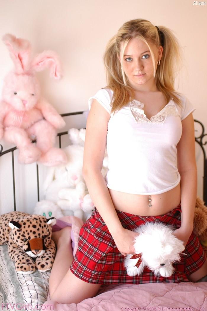 Dirty schoolgirl poses on a bed - Alison - 2