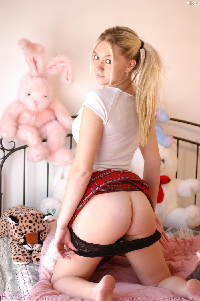 Dirty schoolgirl poses on a bed - Alison - 3