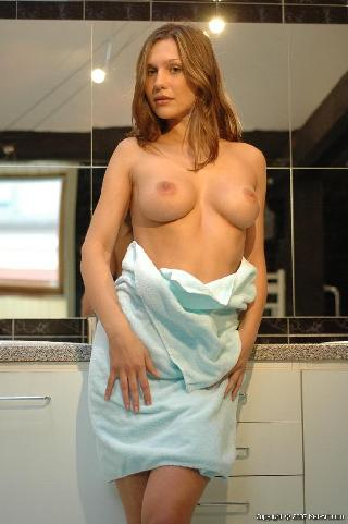 Bewitching girl is going to take a warm shower - Zdena A