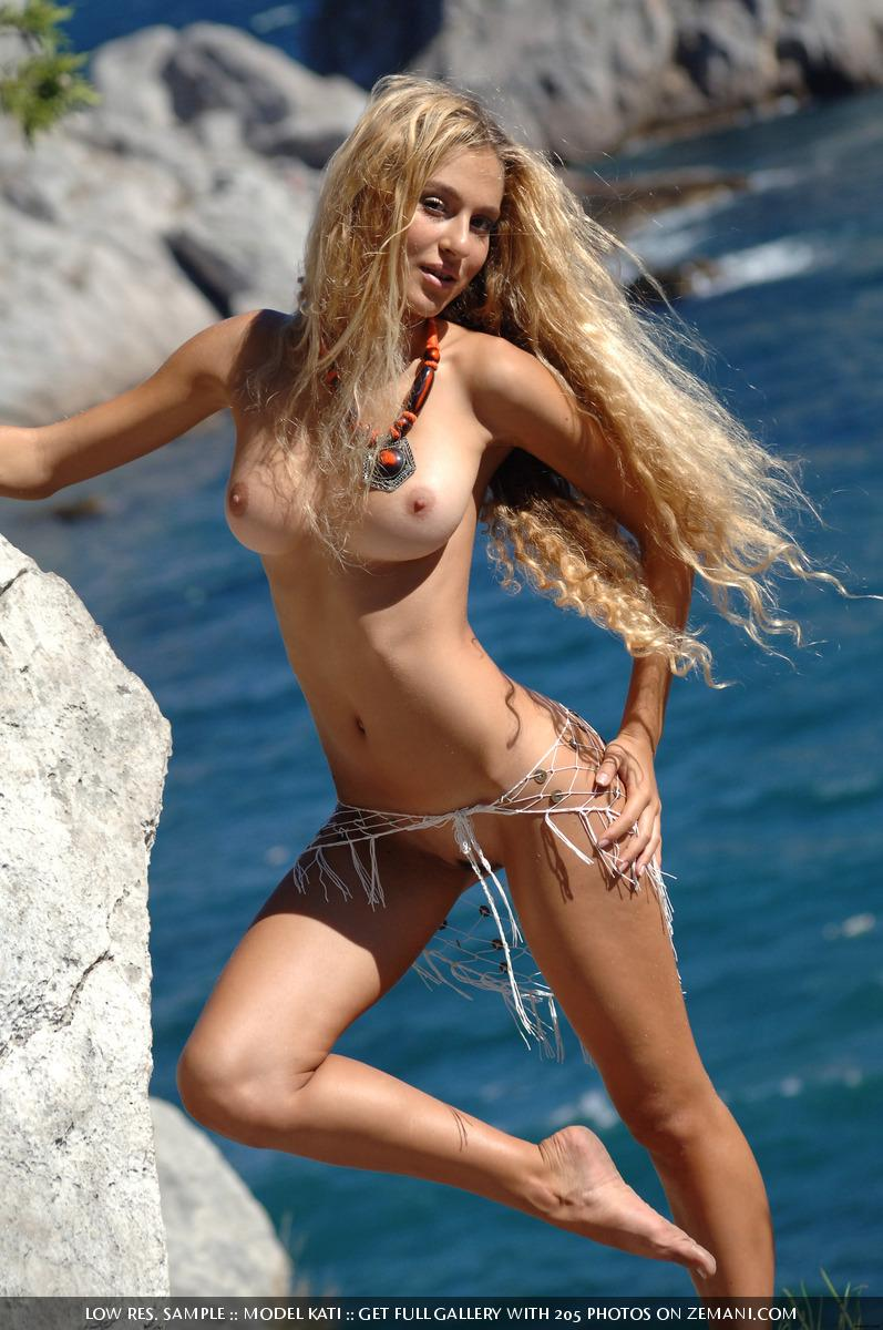 Blonde chick is stripping on the sea cliff - Kati - 3